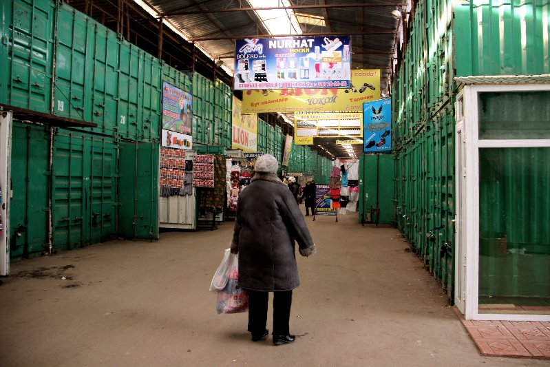 Shopper in front of Containers