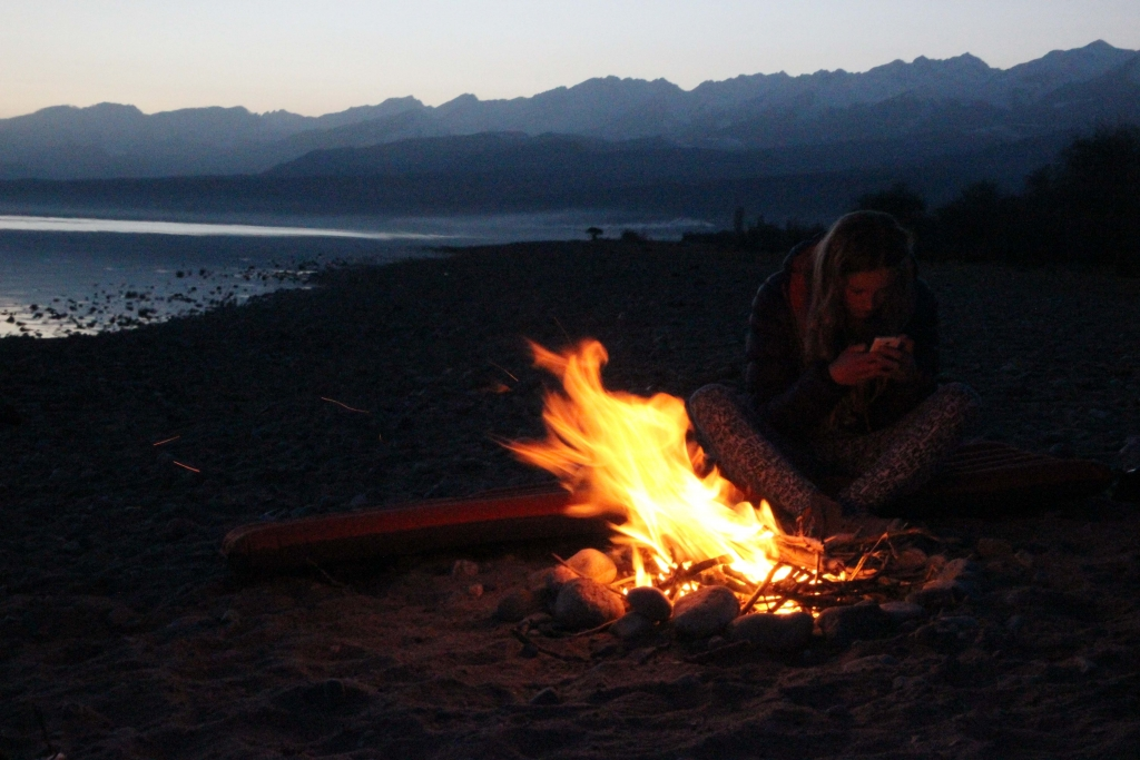 Camp fire at lake Issyk-Kul
