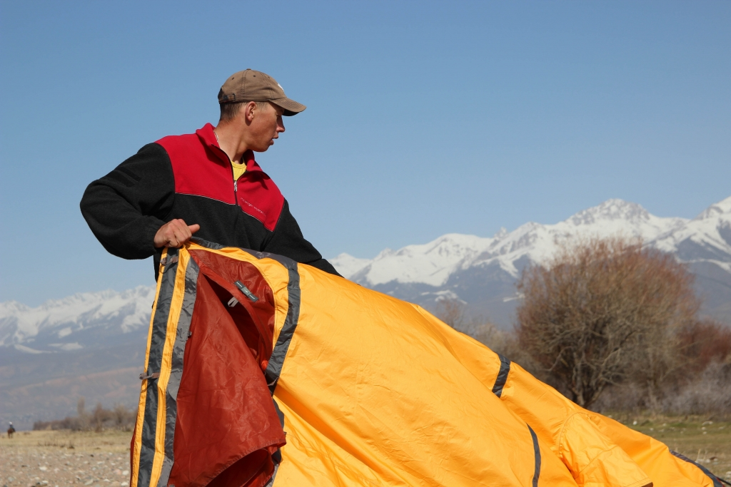 Setting up the tents at lake Issyk-Kul