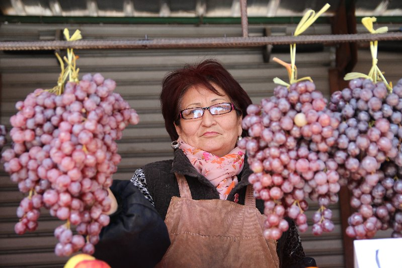 Woman selling Grapes