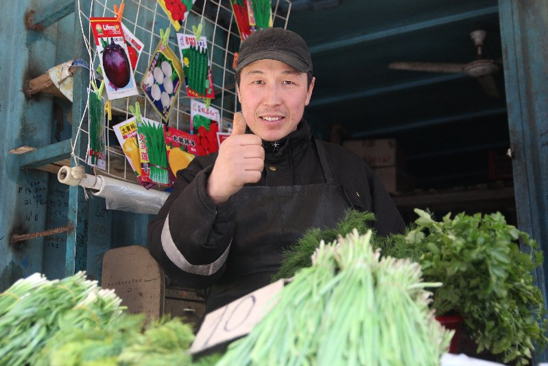 Man selling Cabbage